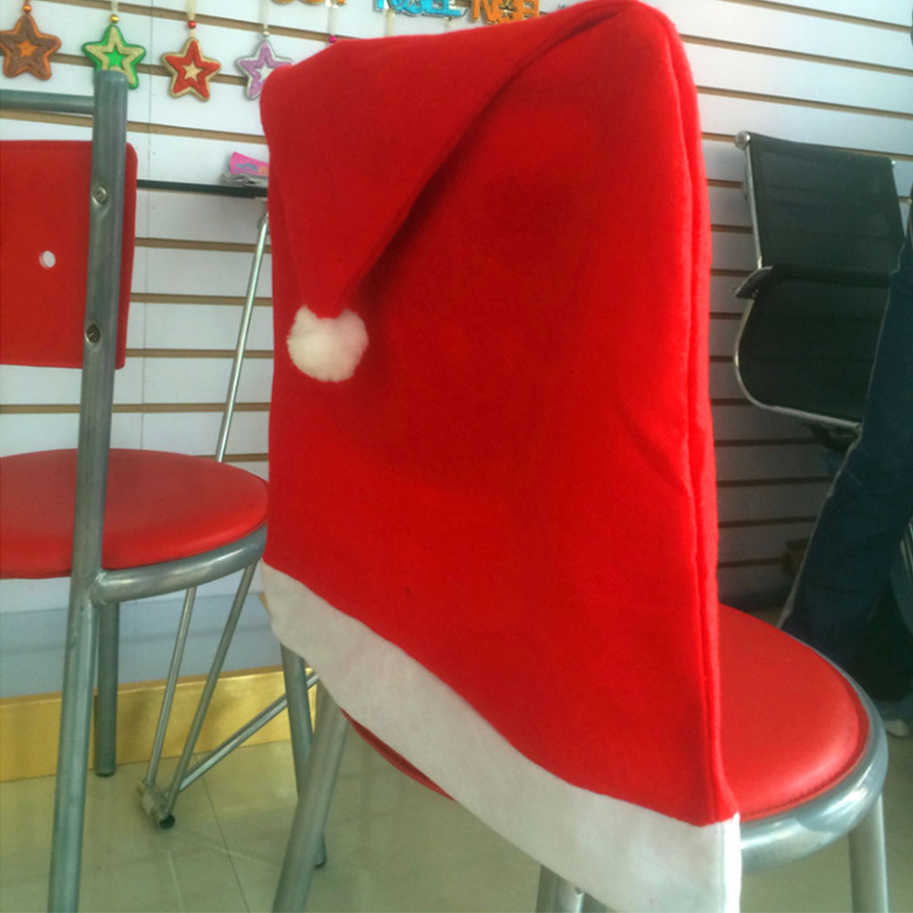 Santa red hat chair covers christmas decorations dinner for Christmas decorating ideas for dining room chairs